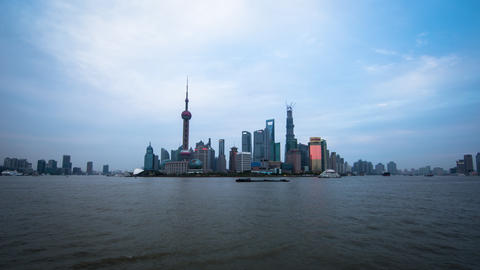Wide Time Lapse Of Boats Floating By With Towers In The Back In Shanghai China,  stock footage