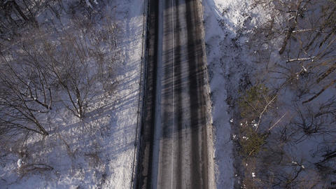 Aerial - Driving Cars On A Rural Road In Winter stock footage