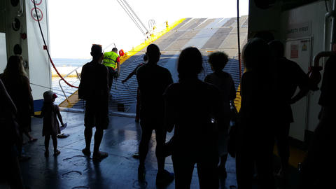 Tinos Port, Cyclades. Passengers In Greek Car-truck Ferry With Open Door To Port stock footage