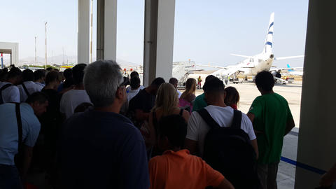 Mykonos Airport (JMK) Greece – Summer 2015. Passengers Of Delayed Flights Wait stock footage