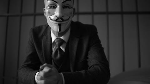Anonymous Hacker Seated In Prison (B/W Version) stock footage