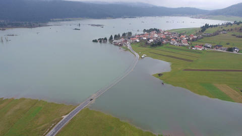 Aerial - Vehicle Trying To Cross The Flooded Road stock footage