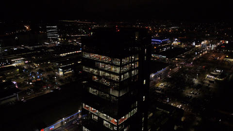 Aerial - Skyscraper With Bright Illumination Office Interior At Night stock footage