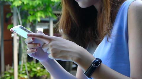 Asian Women Play Mobile Phone stock footage