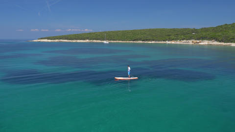 Aerial - Flyover SUP Boarder Above The Anchored Sailing Boat (Part 1) stock footage