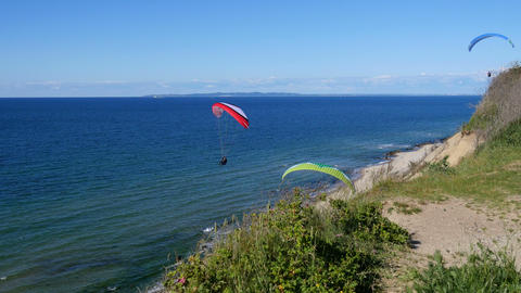 Paragliders enjoying the good wind along the coast Footage
