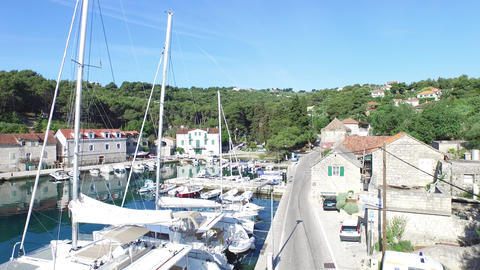 Aerial Drone Scene Of Harbor In Solta, Croatia. Detail Of Dock Where The Sailboa stock footage