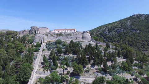 Aerial Drone Scene With Castle On Top Of A Mountain. Small European City Below.  stock footage