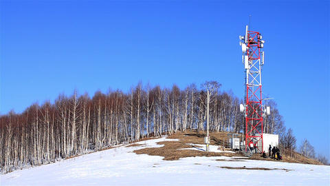 Cell towers on top of a hill near which stopped a group of tourists 09 Footage