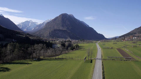 Aerial - Highland Landscape With Car Road And Snowy Mountains stock footage