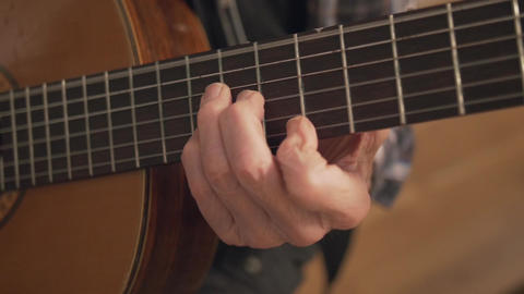 Old Retired Senior Man Hands Playing Guitar Closeup stock footage