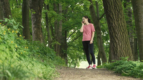 Girl Talking By Cell In The Park stock footage