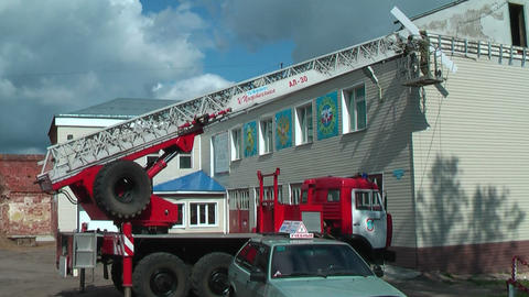 Builders reconstruct building by fire truck Footage
