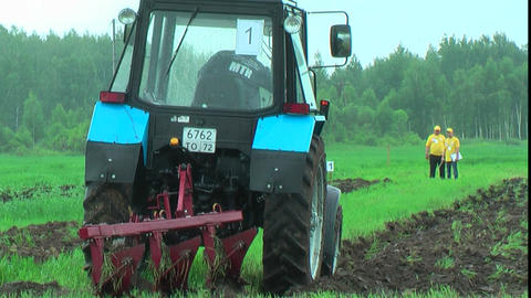 Tractor Operator Plows The Site In Rain stock footage