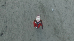 4k Aerial Shoot Above A Child On The Beach stock footage