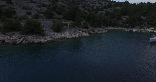 Aerial Scene Of Coastline In A Croatian Bay. Detail Of Catamaran Anchored. Drone stock footage
