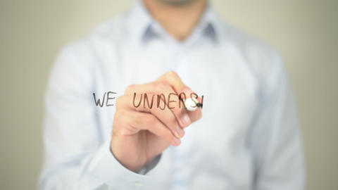 We Understand Your Needs , Man Writing On Transparent Screen stock footage