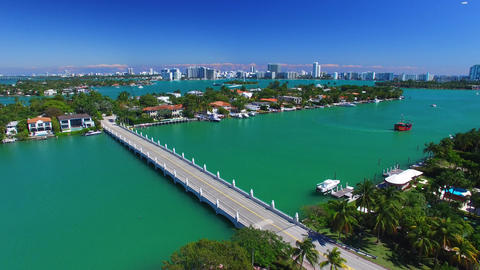 Aerial View Of Palm Island And Miami With Red Cruise Boat In Canal stock footage