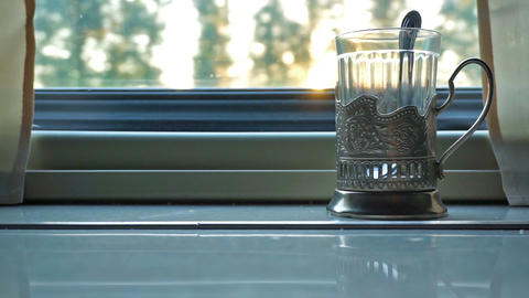 cup holder on table near window in moving train ビデオ