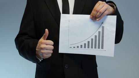 Businessman Shows Printed Charts stock footage