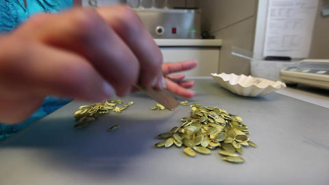 Woman sorting pumpkin seeds Footage