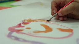 kid drawing with brush watercolor paint Footage