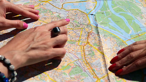 Close Up Of Women's Arms Pointing Map With Fingers stock footage