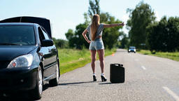 Beautiful Girl Hitchhiking On Rural Road Back View stock footage