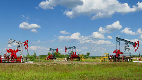 Many Working Oil Pumps In A Row At Sunny Day stock footage