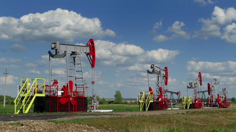 Working Oil Pumps In A Row At Sunny Day stock footage