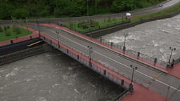 Small Road Bridge Cross Fast Torrent With Gray Cloudy Water Stream, Wet Asphalt stock footage