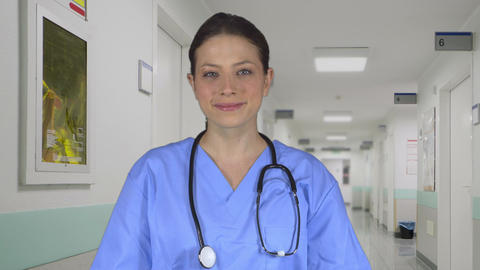 Beautiful Female Medical Professional Standing In A Clinic stock footage