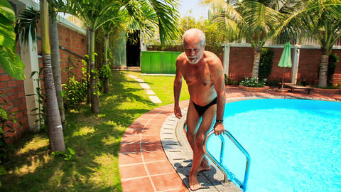 Bearded Old Man Comes out of City Pool by Ladder Closeup Footage
