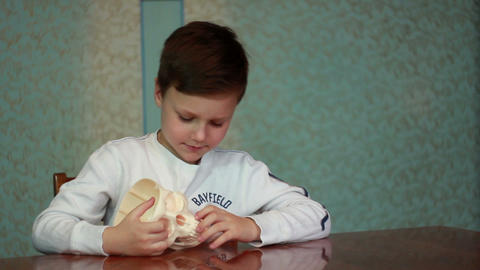 Boy plays with skull 1 Footage