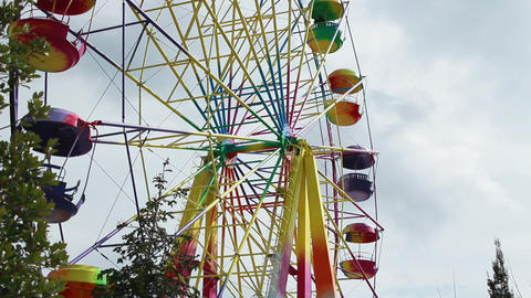Colored Ferris Wheel On A Cloudy Day stock footage