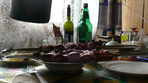 Lunch At The Table, Barbecue, Boiled Potatoes, The Beer Is Poured From A Plastic stock footage