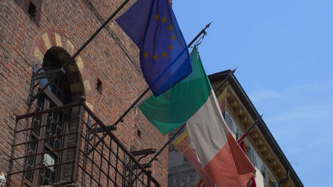 Italian And European Flag Attached To A House stock footage