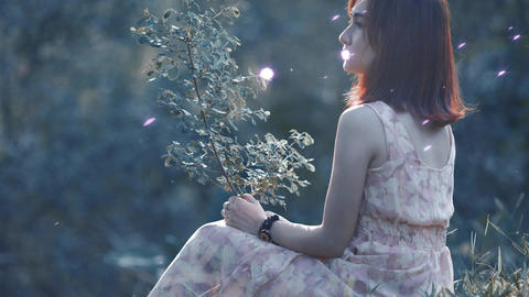 Girl In Cherryblossome Particles stock footage
