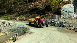 NEPAL – MARCH 18 2016: Tractor Rides Mountain Road. Himalayas HD Video stock footage