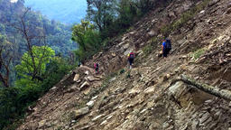 Hikers Backpack Cross Mountain Steep Road. Himalayas Nepal HD Video stock footage