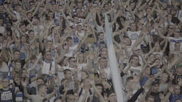 The Crowd Of Football Fans At The Stadium Clap Their Hands During A Match stock footage
