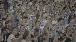 People At The Stadium During The Game, Clap Their Hands. A Crowd Of Fans stock footage