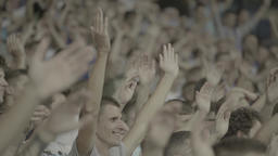 Many Hands Of The Fans Clap In Rhythm During The Game stock footage