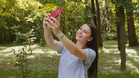 Happy Young Woman Taking Selfie With The Smartphone In The Park stock footage