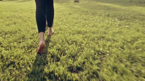 Young Woman Playing Soccer Football on Summer Grass Slow Motion - Warm Graded Lo Footage
