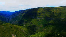 Portugal Madeira 4k Aerial Video. Mountain Forest Valley Hills Blue Sky Clouds stock footage
