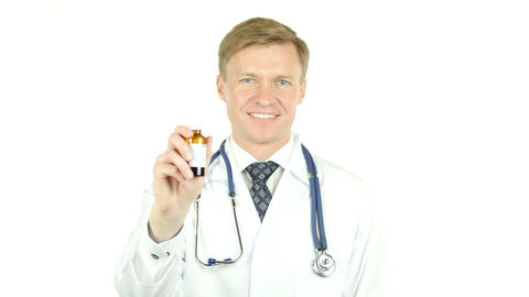 Doctor Holding Syrup for Treatment of Patient Footage