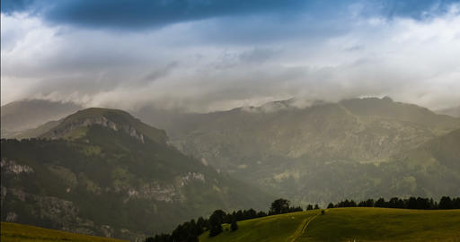 4K, Time Lapse, Godrays And Rain Over French Mountainrange stock footage