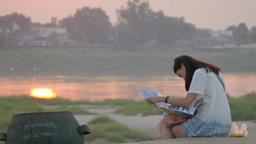 Tourist Lady Looking On Map At Sunset,Vientiane,Laos stock footage