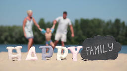 Blurred Background Of Family Playing On The Beach stock footage